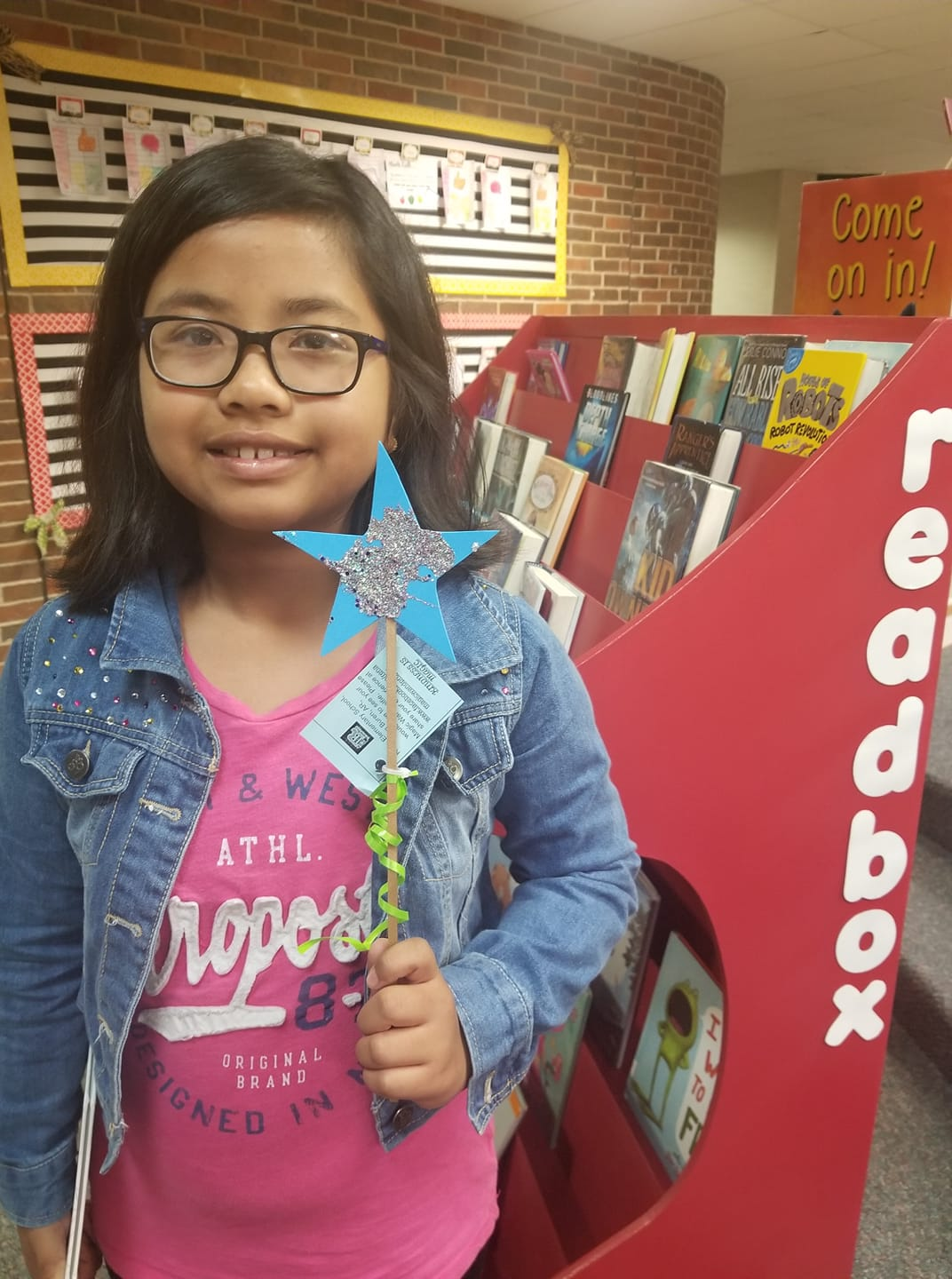 "Rena students wave ""Magic Wands of Kindness"""